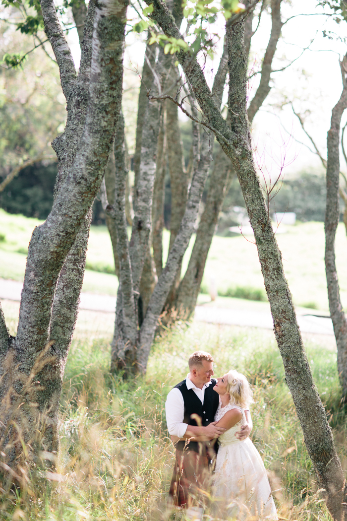 A Tea Length Wedding Dress for a Fabulously Relaxed, 1950s Inspired Wedding from Emily Raftery Photography - Bride & Groom