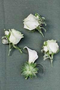 White Boutonnieres - A Vintage Inspired City Wedding in a Crisp and Elegant Palette of Ivory, Black & Green
