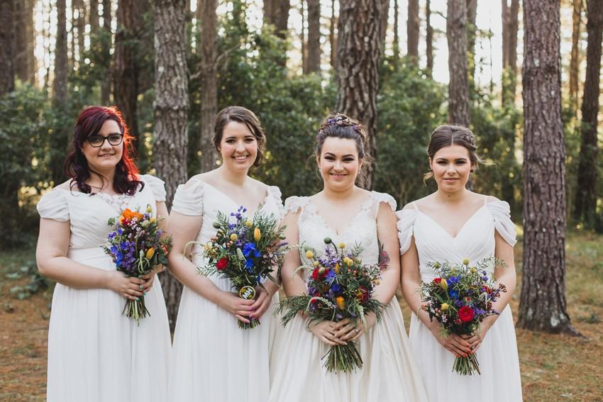 Bride and bridesmaid in white