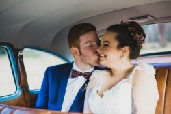 Bride & groom in the backseat