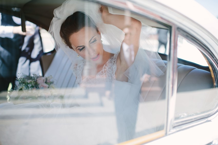 Bride Arriving in a Vintage Car