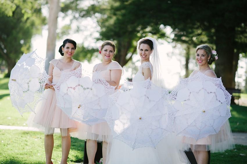 Bride & Bridesmaids with Parasols Photography by Claire Morgan