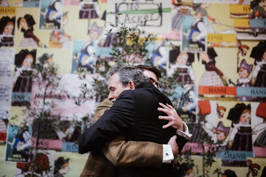 Groom hugging his parents