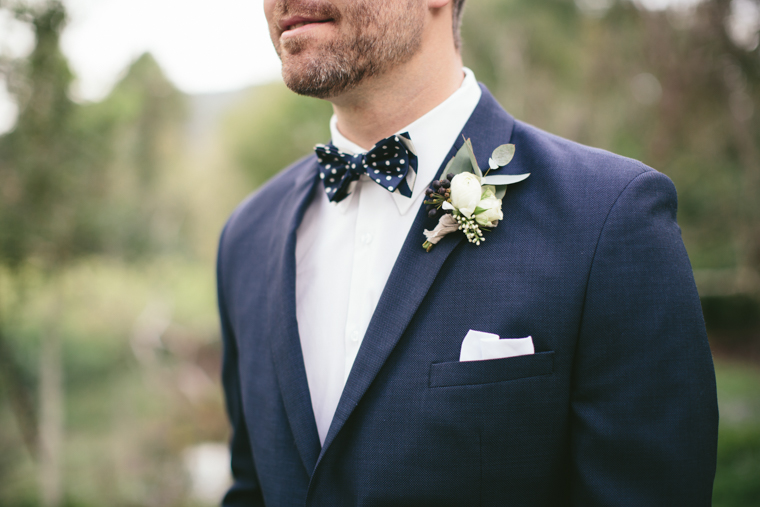 Groom wearing a Blue Suit & Polka Dot Bow Tie // Photography - White Images