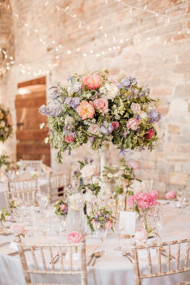 White Candlestick Floral Wedding Centrepiece