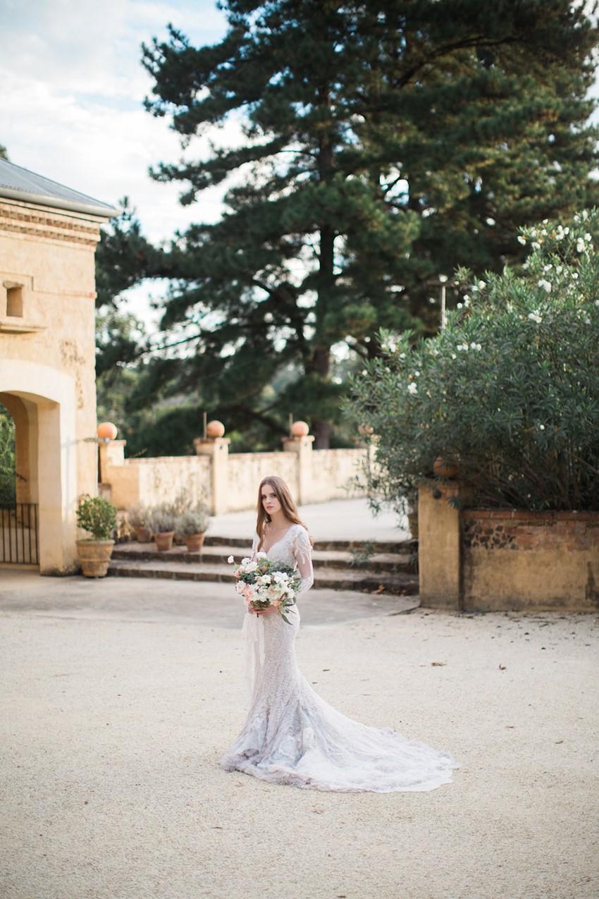 A stunning long sleeve fishtail wedding dress // Photography ~ White Images