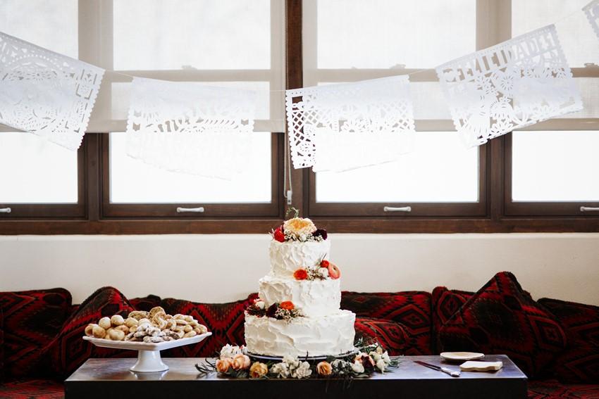 3 Tier Flower Adorned White Wedding Cake // Photography ~ Elizabeth Wells Photography