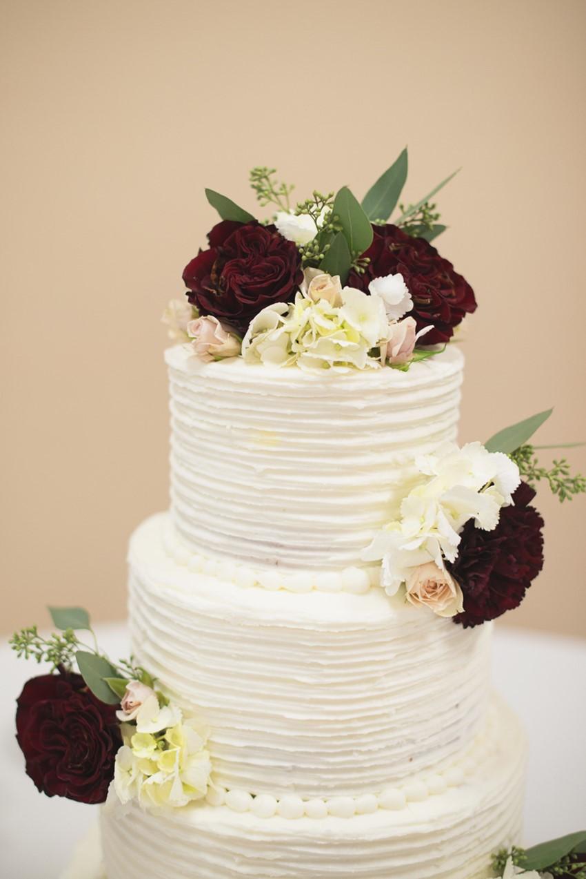 Flower Topped White Wedding Cake