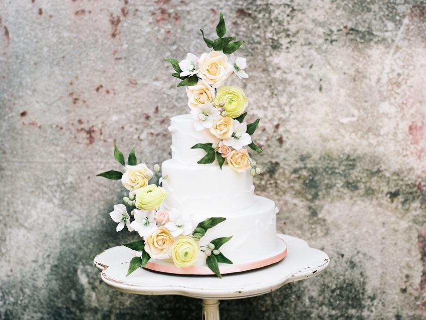 Peach & Yellow Flower Topped Wedding Cake
