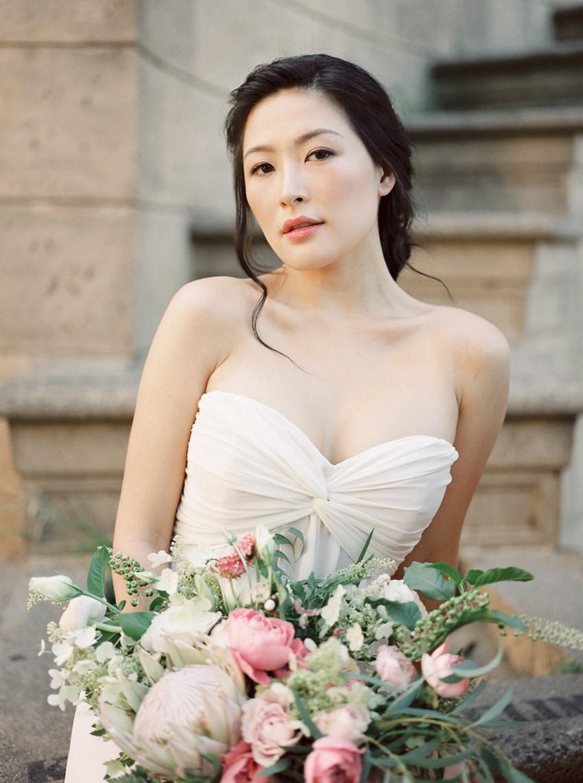 Modern Vintage Bride in a Strapless Wedding Dress with Pink Bridal Bouquet