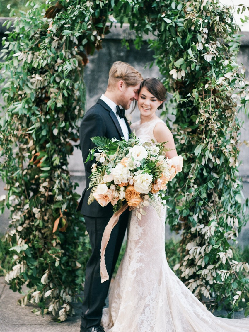 Bride & Groom with Greenery Wedding Ceremony Arch