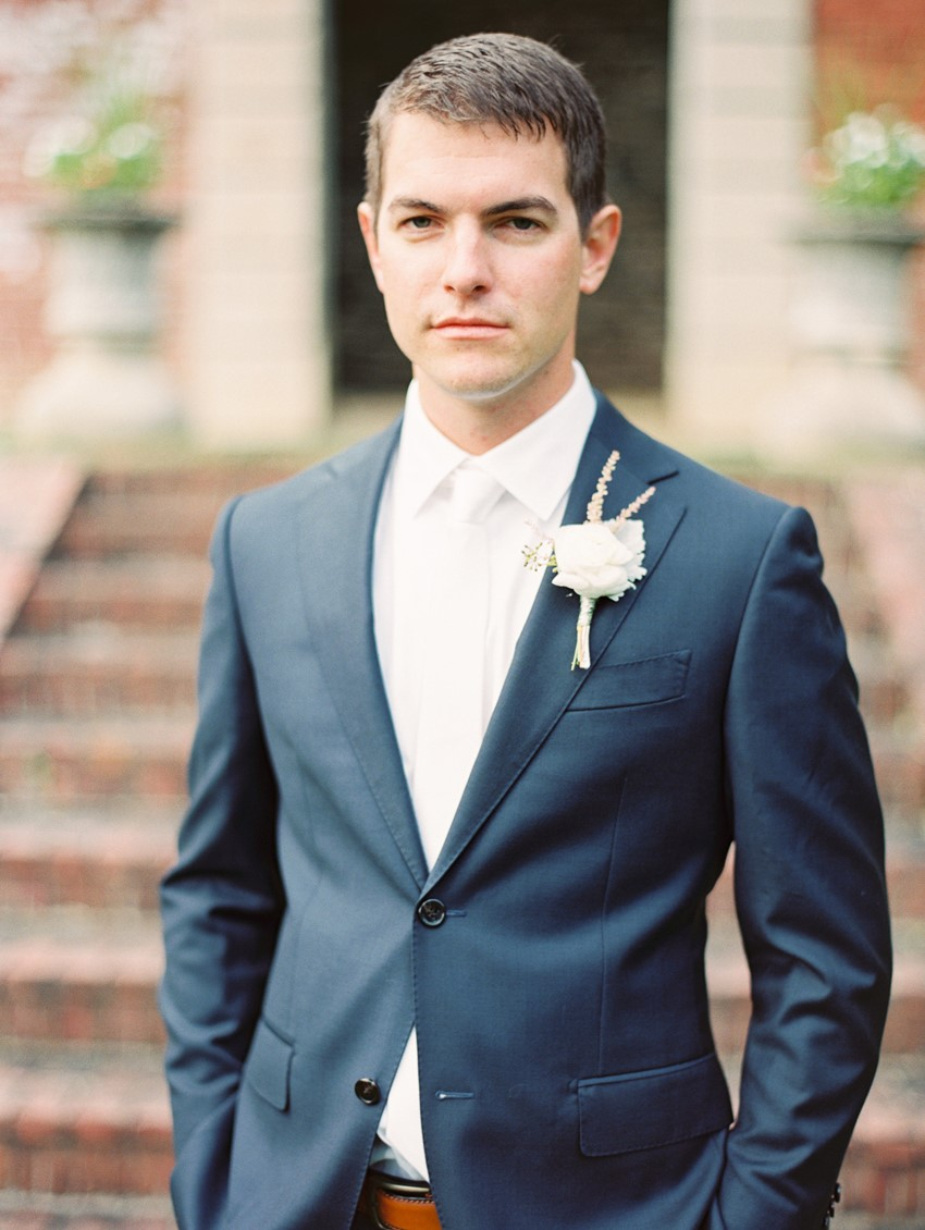 Groom in a Navy Suit & White Tie