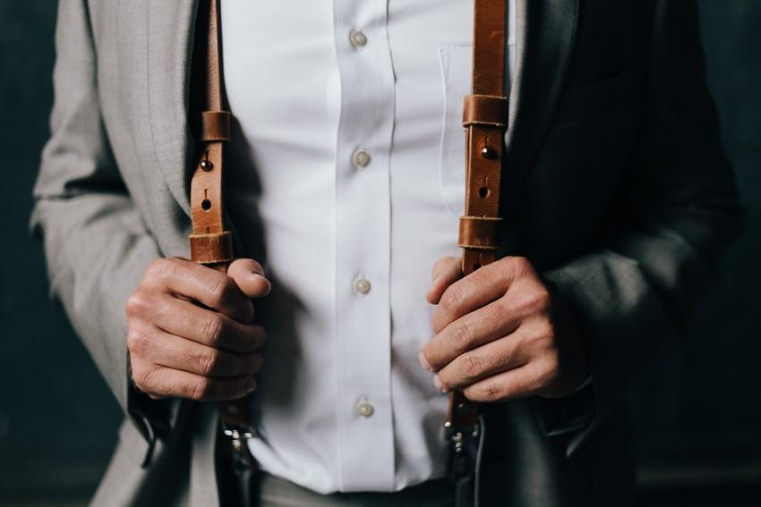 Groom Wearing Suspenders