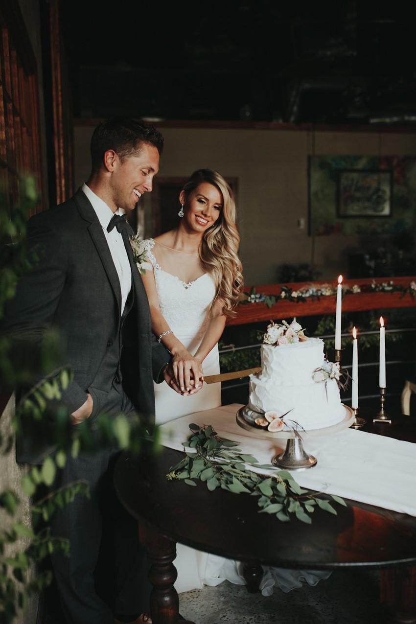 Glamorous Bride & Groom Cutting the Cake