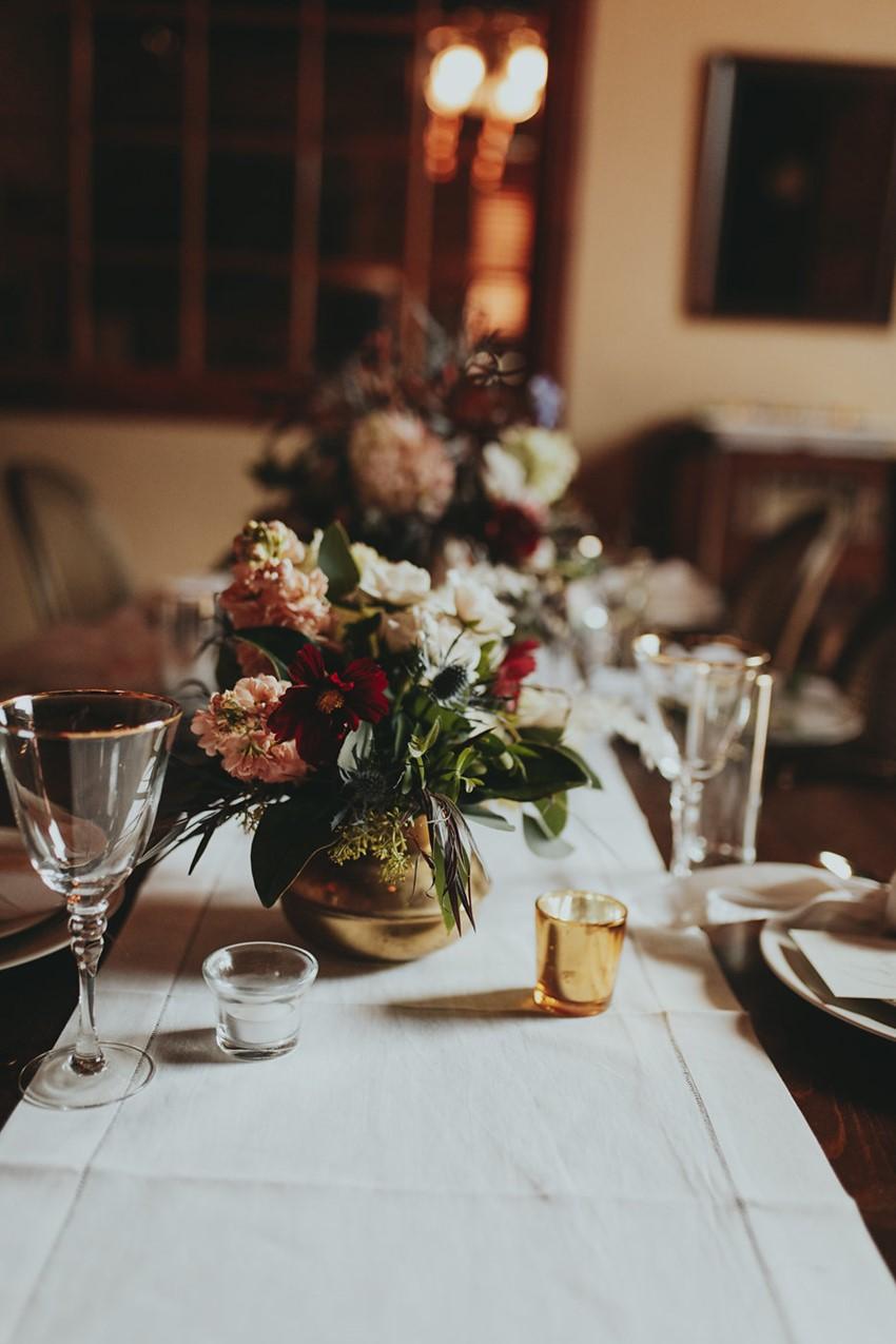 Low Floral Wedding Centerpiece in a Brass Vase