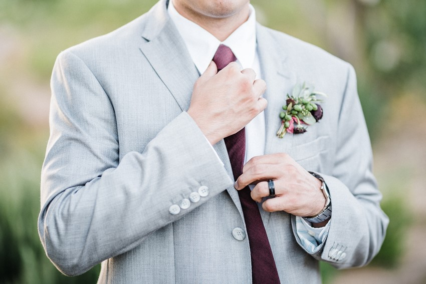 Groom in Grey Suit with Burgundy Tie & Boutonniere