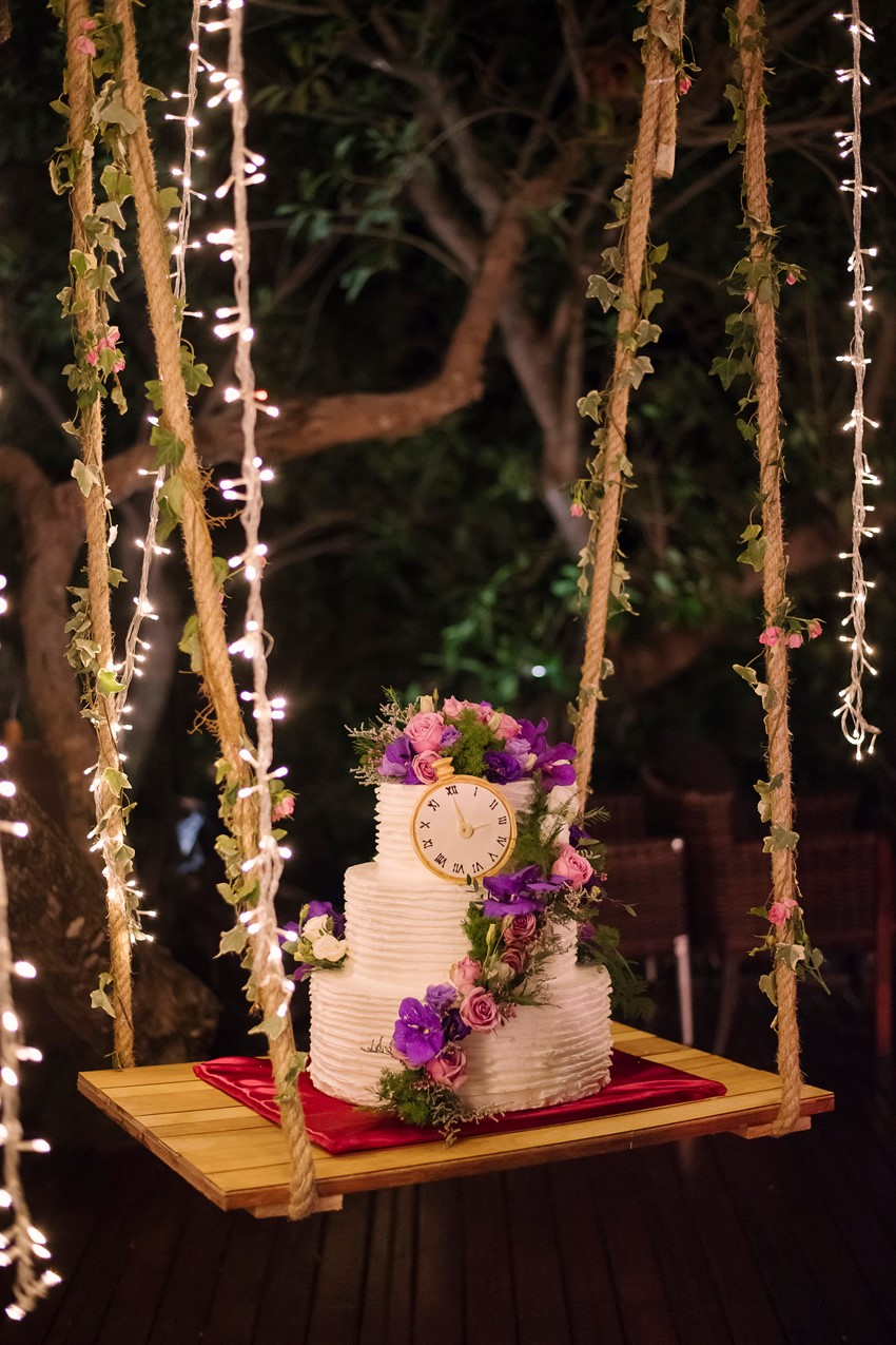 Floral Topped Wedding Cake on a Swing