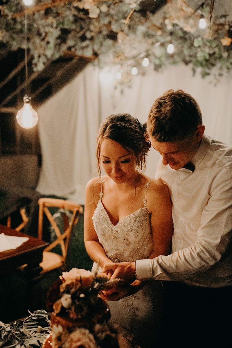 Canada Fall Greenhouse Wedding Cutting the Cake