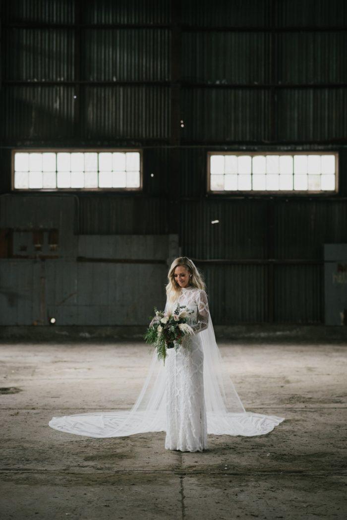 Bride in a long sleeve wedding dress